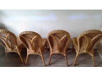 round expandable table and 4 wicker chairs
