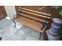 GARDEN BENCH WITH WROUGHT IRON ENDS/LEGS