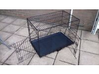 Large black dog crate.