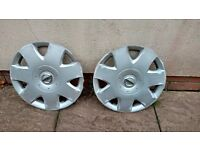 two nissan wheel trims 15 inch