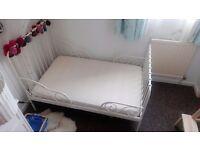 Ikea MINNEN extending childrens bed. White metal decorative frame.