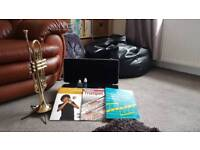 Trumpet with hard case 3 music books stand and 2 bottles of valve lubricant