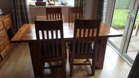 Acacia wood dining table and chairs