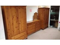 Pine bedroom furniture set with a walnut finish.