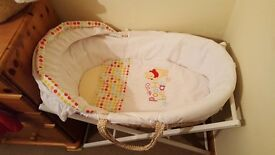 Beatiful winnie the pooh moses basket for sale.