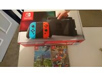 Nintendo switch new with two sealed games