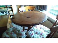 small circular pine pedestal table and 3 pine chairs