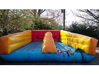 Inflatable bouncy castle bungee run