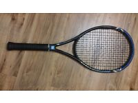 Wilson tennis racket with a cover