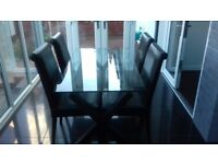 Glass Habitat Table and Four Chairs