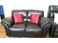 ***lovely prac- new blk leather sofa with footstool*** bargain- space needed