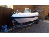 Boat with engine and trailer very good condition