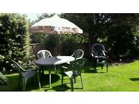 Green plastic table n chairs set with parasol