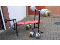 Weight bench with 160 lbs of weights. Bar and two dumbbells