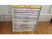2 wii consoles + 14 games + accessories + instructions