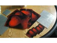 Red and black placemats and coasters