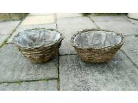 Pair of rustic wicker hanging baskets