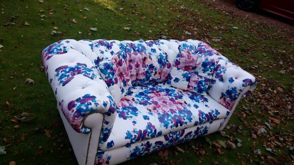 Two seater chesterfield sofa with floral design print