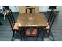 Antique solid wood dining table and 5 chairs