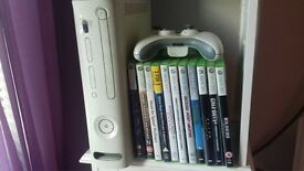 xbox 360 with 12 games and 2 controls