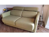 Sofabed. 2/3 seater in attractive green. Easy single-action pull out. Great quality