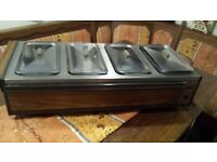 food warmer hostess with 4 glass rectangular dishes with lids in very good condition.
