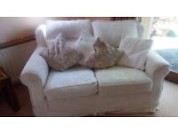 Two Cream 2 seater sofas and chair