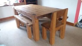 Solid pine beam dining table and 2 chunky chairs.