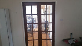 Pair of Oak Stained Glazed Interior Doors