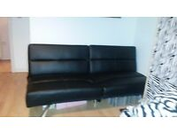 Black leather sofa bed for sale Good condition