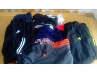 Adidas trainers, tracksuit bottoms and tshirts.