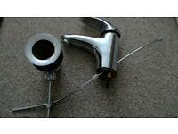 Bathroom basin mixer tap with waste
