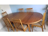 Extendable kitchen dining table with six chairs
