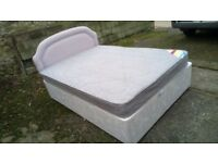 "4' 6"" Divan bed with lilac fabric headboard"