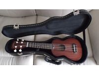 Concert Ukulele by Redwood in a black padded hardcase. Both are in showroom condition.