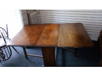 SOLID OAK GATE LEG EXTENDING DINING TABLE REALLY NICE DESIGN AND SOLID STRUCTURE SIZE BELOW