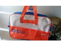 """""""Gio"""" style gym bag. Orange, blue and white, attractive looking."""