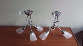 Pair of three-armed chrome light fittings