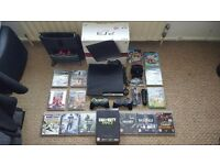 Sony PS3 Slim 120gb + 15 games + 2 controllers + Extras