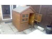 "4' x 4' wooden playhouse (4'6"" high)"
