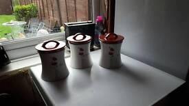 Tea coffee sugar jars.