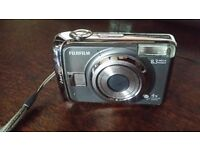 look bargain fujifilm digital camera with lcd screen on rear and camera case £9.99