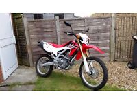 Honda CRF 250L. Barley run in at 801 miles, as new both keys, still under warranty until 24/07/2017
