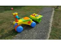 Ride on toy with trailer and zogg swim ring for babies