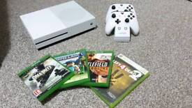 ONO.Xbox One s, with two controllers, charging dock, and 4 games