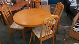 Oak style round dining table and 4 chairs