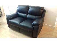 Black leather 2 seater double recliner sofa. Great condition.