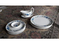 Dinner plate set in Wedgewood Clementine bone china with matching gravy boat and dish