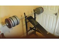 Weights bench with weights, barbell and leg extention attachment