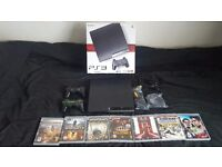 Sony Playstation 3 slim 120gb console with 2 controllers and 11 games